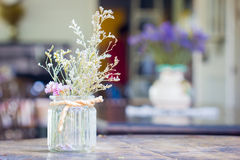 Dry flowers in glass vase with rope on blurred background, copys Royalty Free Stock Images