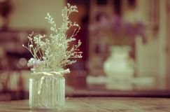 dry flowers in glass vase with rope on blurred background, copyspace. Vintage retro style royalty free stock images