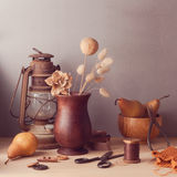 Dry flowers and pears on wooden table. Rustic still life Royalty Free Stock Images