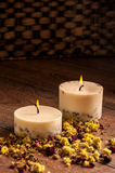 Dry flowers petals and candles Royalty Free Stock Photography