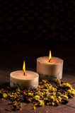 Dry flowers petals and candles Stock Photo
