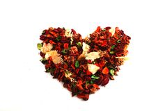 Dry flowers in shape of heart Stock Image