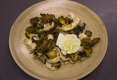 Dry flowers in a wooden plate Stock Photo