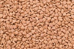 Dry food for cats or doggs - kibble. Organic texture background stock photos