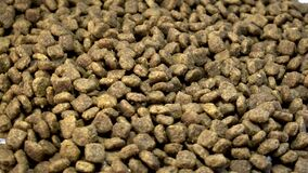 Dry food for cats and dogs. Pet meal rotating. Selective focus stock video