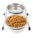 Dry food for pets with water in metal bowls Stock Photo