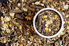 Dry food for rodents in bowl dark background top view Stock Photo