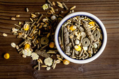 Dry food for rodents in bowl wooden background top view Stock Photo