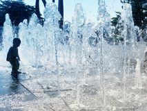 Dry Fountain And Kid On A Hot Day royalty free stock images