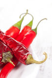 Dry and fresh red hot chili peppers. Stock Photo