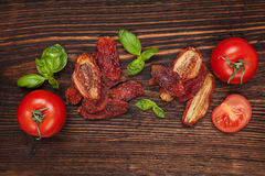 Dry and fresh tomatoes. Royalty Free Stock Photos