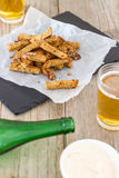 Dry-Fried Garlic Bread Sticks - Party Snack. These garlic sticks make an incredible snack that goes hand in hand with beer. Crispy stripes of sourdough bread dry Royalty Free Stock Photography