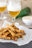 Dry-Fried Garlic Bread Sticks - Party Snack. These garlic sticks make an incredible snack that goes hand in hand with beer. Crispy stripes of sourdough bread dry Stock Image