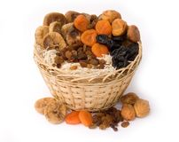 Dry fruit in a basket. On a white background Stock Photo