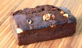 Dry fruit cake. Closeup shot of dry fruit cake on wooden background royalty free stock photo