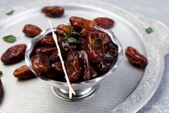 Dry fruit dates on silver tray. Copy space. Dry fruit dates on silver tray. Copy space Royalty Free Stock Image