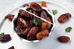 Dry fruit dates on silver tray. Copy space Royalty Free Stock Photos