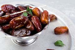 Dry fruit dates on silver tray. Copy space. Close up Stock Photo