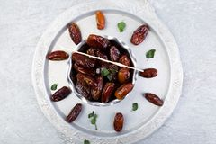 Dry fruit dates on silver tray. Copy space. Top view Stock Images