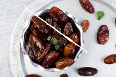 Dry fruit dates on silver tray. Copy space. Top view. Dry fruit dates on silver tray. Copy space. Top view Royalty Free Stock Photo