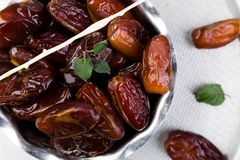 Dry fruit dates on silver tray. Copy space. Top view. Dry fruit dates on silver tray. Copy space. Top view Stock Photos