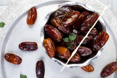 Dry fruit dates on silver tray. Copy space. Top view. stock photo