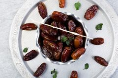 Dry fruit dates on silver tray. Copy space. Top view Stock Photos