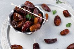 Dry fruit dates on silver tray. Copy space. Top view. Dry fruit dates on silver tray. Copy space. Top view Royalty Free Stock Photography