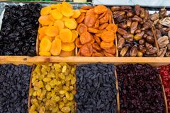 Dried fruit mix at food product market 1. Dry fruit mix on a pile on a food market, coloful dry fruits, dried fruits, different types of dry fruits, Assortment royalty free stock images