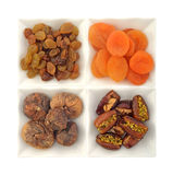 Dry fruit and nuts in white bowls Royalty Free Stock Photos