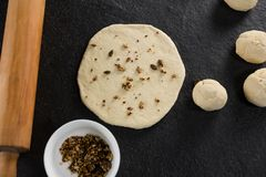 Dry fruits added over flattened dough. Over head view of dry fruits added over flattened dough royalty free stock photography