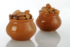 Dry Fruits Almonds in Ceramic Pot on white Stock Photography