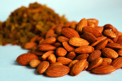 Dry fruits Almonds. Dry fruit almonds with raisins or kismis in background. Photo taken in the month of April, 2016 Royalty Free Stock Image