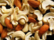 Dry Fruits background. Background of dry fruits comprising of cashew nuts and almonds Royalty Free Stock Photos
