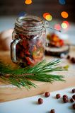 Dry fruits for Christmas cake in alcohol on the table stock photos