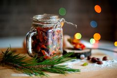 Dry fruits for Christmas cake in alcohol on the table stock photography