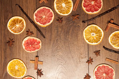 Dry fruits, cinnamon, vanilla and star anis. On wooden background Stock Photos