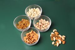 Dry fruits in different bowls Stock Images