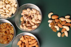 Dry fruits in different bowls Stock Photography