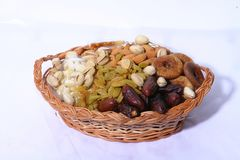 Dry fruits and nuts. In the basket white backgrounds. Pista, cashew & Raisin royalty free stock image