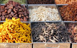 Dry fruits & spices displayed for sale in a bazaar Stock Photos