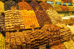 Dry fruits mix at the asian market. Dry fruits and sweets mix sold at the big market Royalty Free Stock Photography
