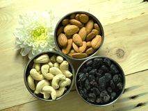Dry fruits top look. Dry fruits from a tabletop angle in brushed steel bowls royalty free stock photography