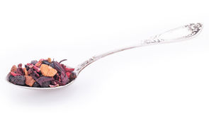 Dry fruits and wild berries in the silver spoon. Isolated on white Royalty Free Stock Photography