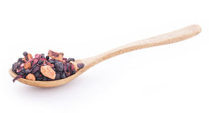 Dry fruits and wild berries in the wooden spoon. Isolated on white Royalty Free Stock Images