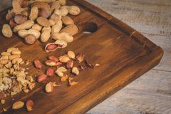Dry fruits on wooden table Royalty Free Stock Images
