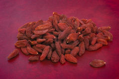 Dry goji berries (Lycium barbarum) on red background Royalty Free Stock Photography