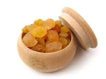 Dry grapes. In wooden pot over white Royalty Free Stock Photo