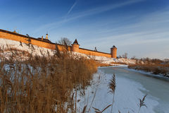 Dry grass in the winter on the background of frozen river and the castle royalty free stock image