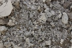 Dry gray brown texture of earth and sand. Dry gray brown background of earth and sand stock photo
